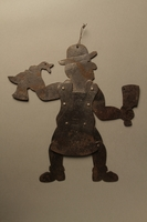 2016.184.596 front Hand cut, movable metal figure of a ritual butcher  Click to enlarge