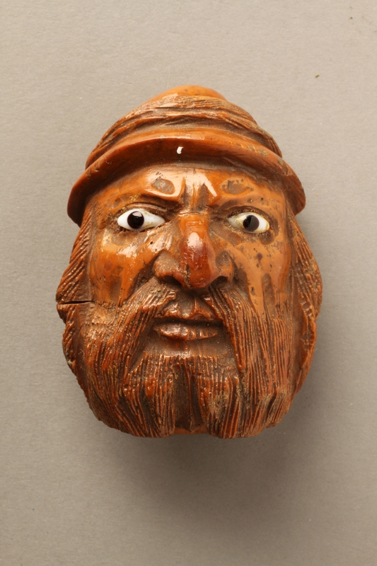 ... 2016.184.597 front Snuff box carved in the shape of an angry looking  Jewish man
