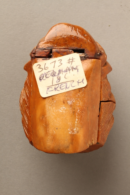 2016.184.597 back Coquilla nut snuff box carved in the shape of an angry looking Jewish man