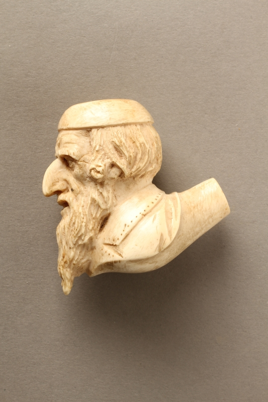 2016.184.598_a left side Ivory pipe with a carved bowl of a Jewish man with beard and kippah