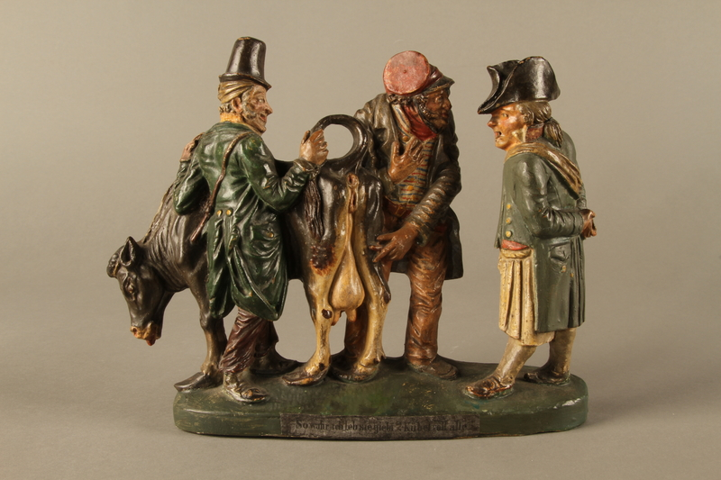 2016.184.602 front Terracotta figure group of 2 Jewish traders selling an old used cow to a gentile