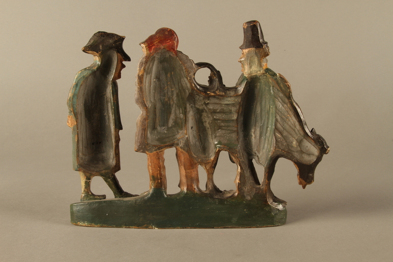2016.184.602 back Terracotta figure group of 2 Jewish traders selling an old used cow to a gentile