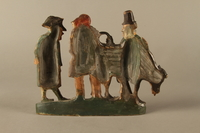 2016.184.602 back Terracotta figure group of 2 Jewish traders selling an old used cow to a gentile  Click to enlarge