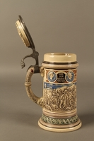 2016.184.603 open Blue, green, and brown beer stein with images of the expulsion of the Jews  Click to enlarge