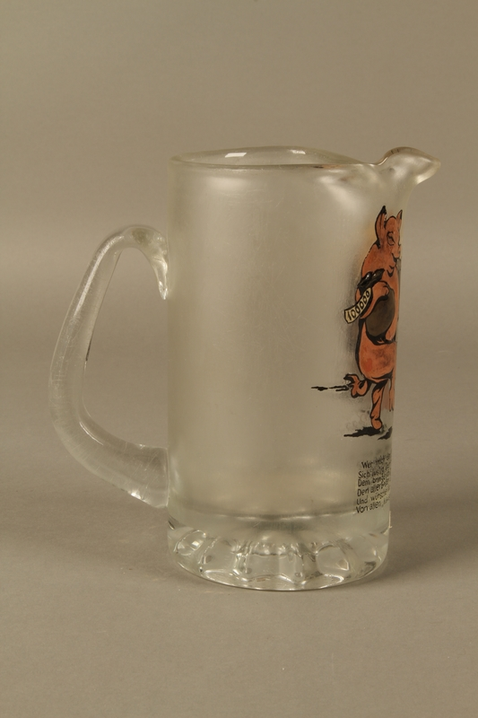 2016.184.604 right side Glass mug painted with a Jewish man dancing with a pig