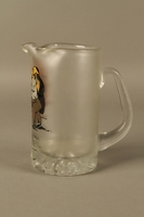 2016.184.604 left side Glass mug painted with a Jewish man dancing with a pig  Click to enlarge