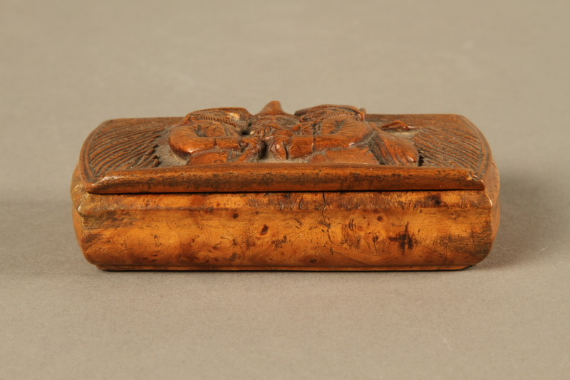 Wooden snuff box with carved trio of hareskin dealers