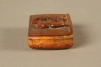 2016.184.606 right side Carved snuff box with a carving of three Jewish hareskin dealers  Click to enlarge