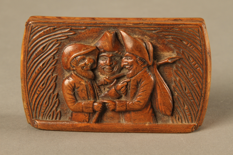 2016.184.606 top Carved snuff box with a carving of three Jewish hareskin dealers