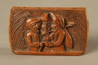 2016.184.606 top Carved snuff box with a carving of three Jewish hareskin dealers  Click to enlarge