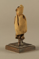 2016.184.611 back Bronze figurine of a Jewish peddler with a burlap sack  Click to enlarge