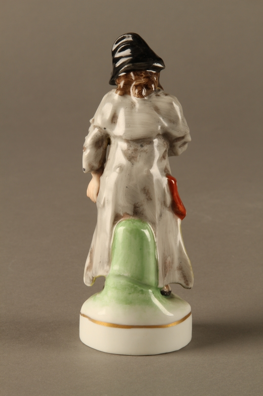 2016.184.613 back Painted porcelain Fagin with his toasting fork