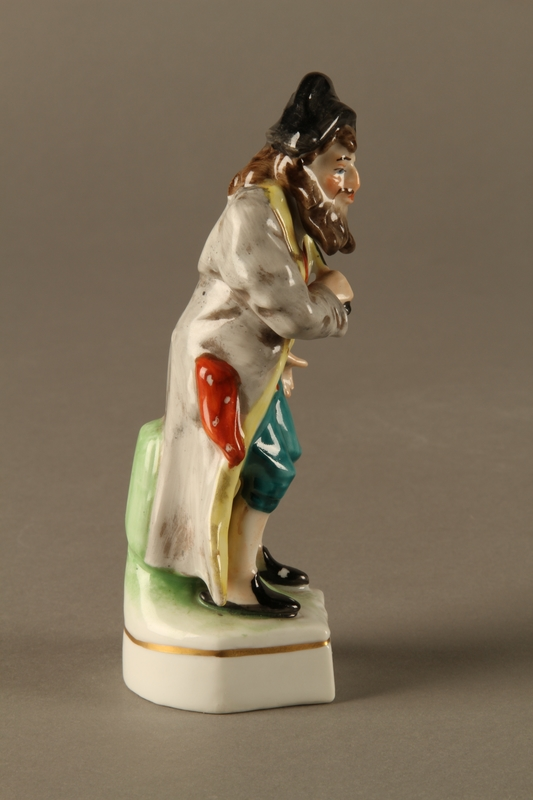 2016.184.613 right side Painted porcelain Fagin with his toasting fork