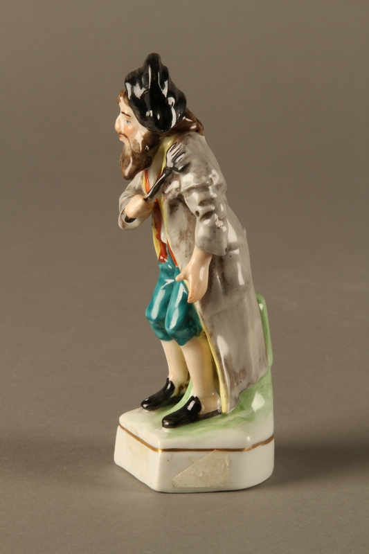2016.184.613 left side Painted porcelain Fagin with his toasting fork