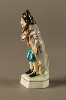 2016.184.613 left side Painted porcelain Fagin with his toasting fork  Click to enlarge