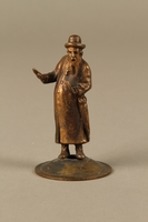 2016.184.615 front Bronze cast figurine of a Jewish matchmaker with his umbrella  Click to enlarge