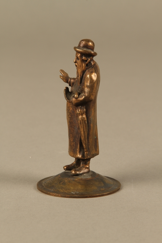 2016.184.615 left side Bronze cast figurine of a Jewish matchmaker with his umbrella
