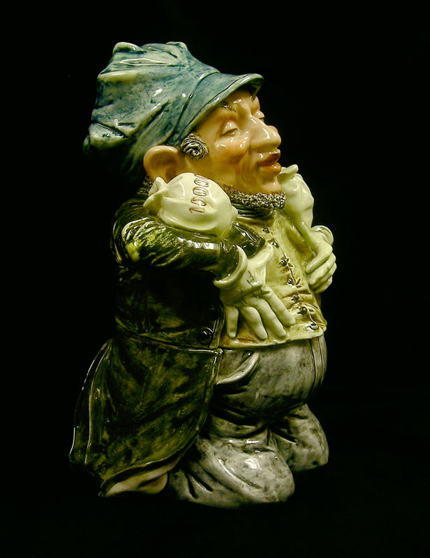 Ceramic cookie jar of a Jewish man kneeling with 2 money bags
