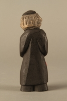 2016.184.622 back Wooden figurine of a Jewish man with a Judenstern and red bag  Click to enlarge
