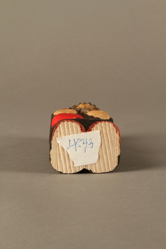 2016.184.622 bottom Wooden figurine of a Jewish man with a Judenstern and red bag