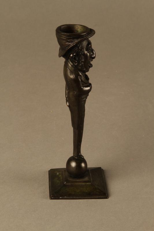 5372bbd5f4f11 Dark bronze candlestick in the shape of a happy Jewish speculator ...