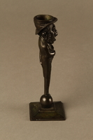 2016.184.626 right Dark bronze candlestick in the shape of a happy Jewish speculator  Click to enlarge
