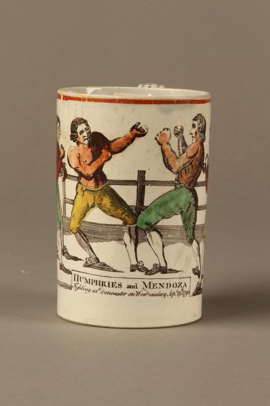 2016.184.630 front Staffordshire pearlware mug, 3rd Mendoza v Humphreys bout