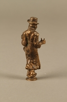 2016.184.631 back Bronze figurine of a Jewish schnorrer in his traditional long coat  Click to enlarge
