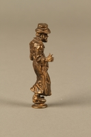 2016.184.631 right side Bronze figurine of a Jewish schnorrer in his traditional long coat  Click to enlarge