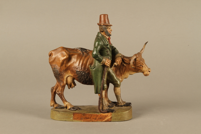 2016.184.633 front Terracotta with a satirical portrayal of a Jewish peddler with an underfed cow