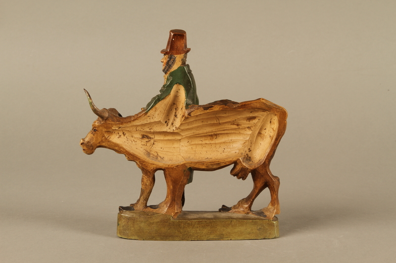 2016.184.633 back Terracotta with a satirical portrayal of a Jewish peddler with an underfed cow