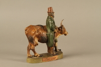 2016.184.633 right side Terracotta with a satirical portrayal of a Jewish peddler with an underfed cow  Click to enlarge