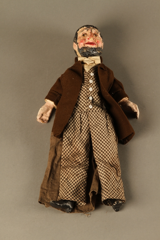 2016.184.639 front Marionette of a bearded Jewish man with a checked skull cap and coat