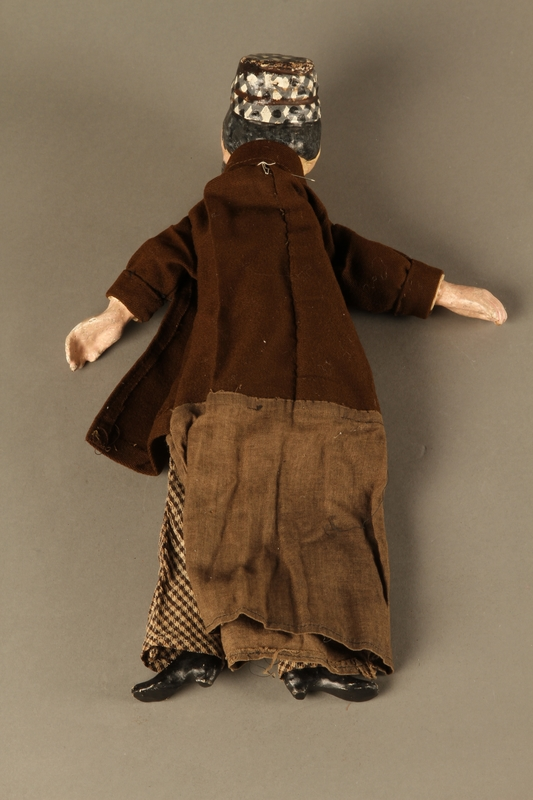 2016.184.639 back Marionette of a bearded Jewish man with a checked skull cap and coat