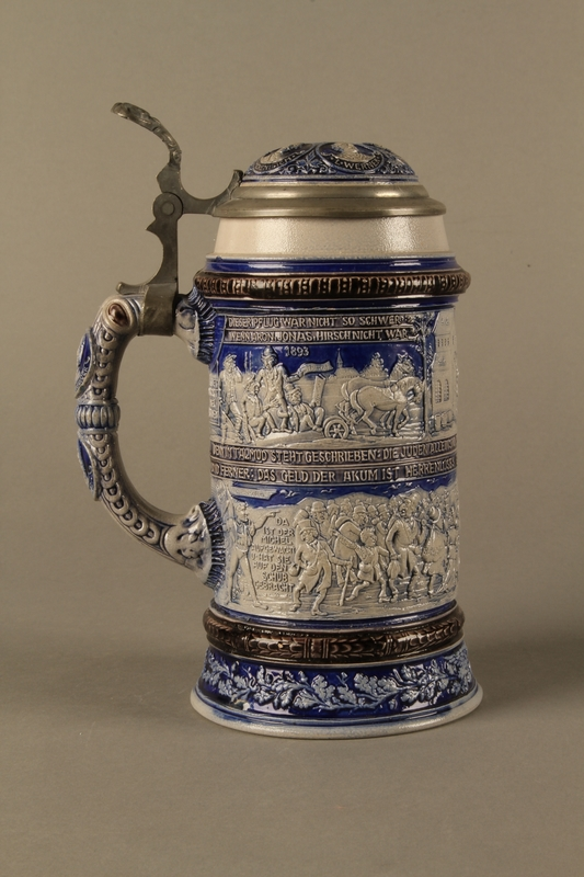 2016.184.640 right side Gray and blue beer stein with images of anti-Jewish fables and politicians