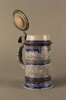 2016.184.640 open Gray and blue beer stein with images of anti-Jewish fables and politicians  Click to enlarge