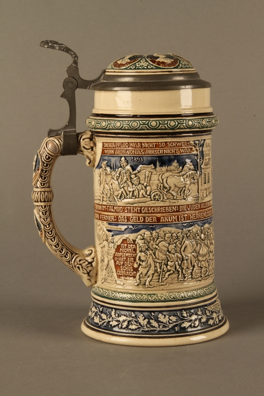 2016.184.641 right side Gray and blue beer stein with images of anti-Jewish fables and politicians