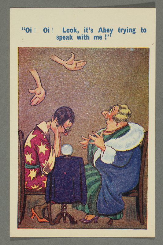 2016.184.753 front Cartoon postcard of a clairvoyant and a Jewish woman at a séance