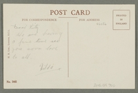 2016.184.766 back Inscribed postcard of a woman holding a stocking in a shop  Click to enlarge