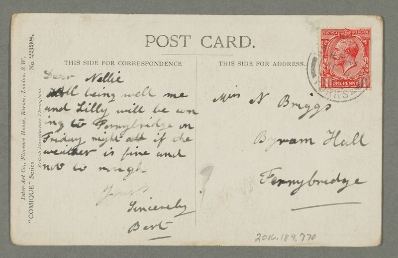 2016.184.770_back Inscribed postcard of 2 Jewish men in an office