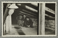 2016.184.785_front Postcard photo of a family in their wartime attic hiding place  Click to enlarge