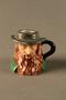 Porcelain match holder resembling Fagin