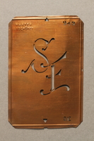 2016.188.2 front Metal tag with the initials SE  Click to enlarge