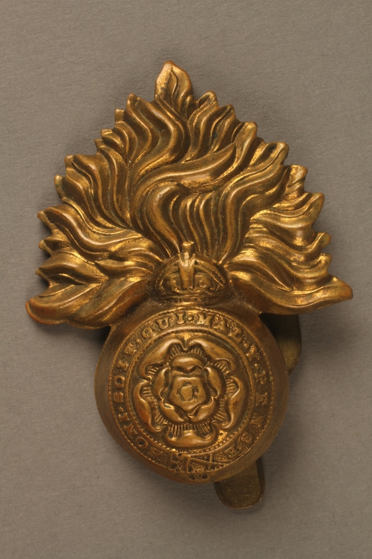 2016.203.8 front Royal Fusiliers cap badge worn by a British soldier and Kindertransport refugee