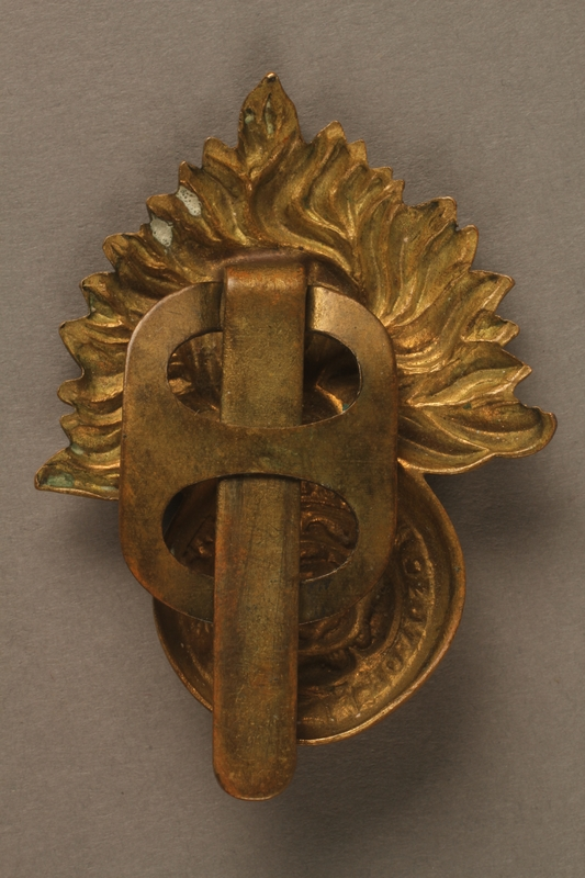 2016.203.8 back Royal Fusiliers cap badge worn by a British soldier and Kindertransport refugee