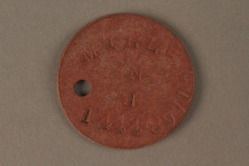 2016.203.9 front Circular identification tag worn by a British soldier and Kindertransport refugee
