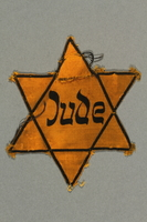 2016.412.2 front Star of David badge with Jude printed in the center  Click to enlarge