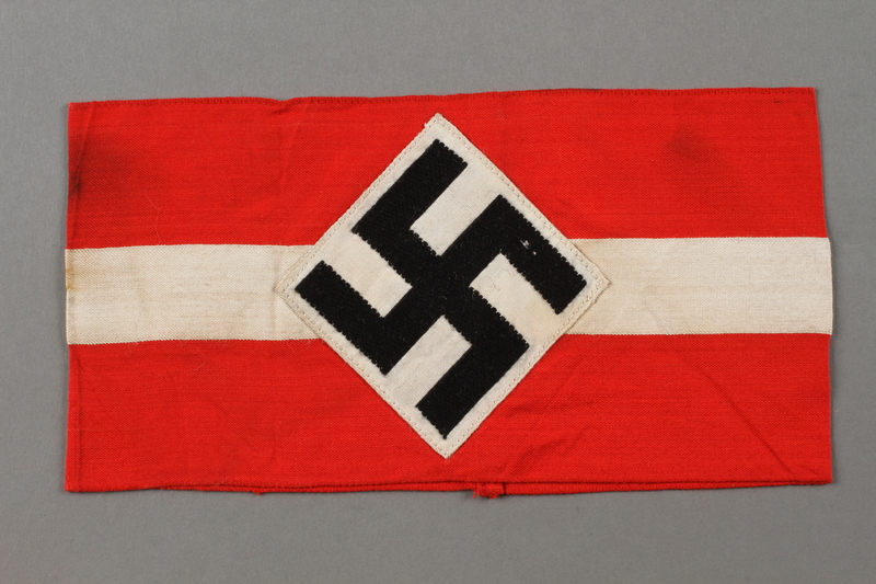2016.412.3 front Red and white Hitler Youth armband with swastika
