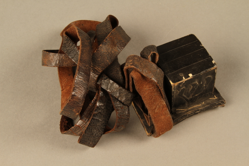 2006.516.4 b side a Pair of Tefillin and pouch owned by a Romanian Jewish concentration camp survivor