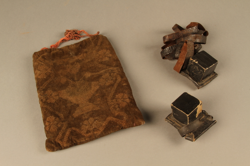 2006.516.4 a-c front Pair of Tefillin and pouch owned by a Romanian Jewish concentration camp survivor